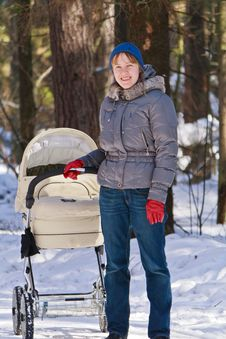 Mother Walking With Baby Carriage In Winter Royalty Free Stock Photography