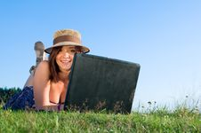 Smiling Beautiful Woman Laying On Grass Royalty Free Stock Photo