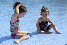 Free Two Small Girls Are Playing In The Swimming Pool Royalty Free Stock Photography - 20698377