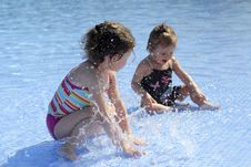 Free Two Small Girls Are Playing In The Swimming Pool Royalty Free Stock Photos - 20698548