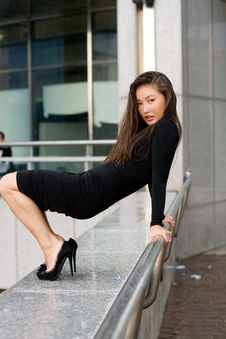 Sexy Girl In Black Dress Walking Stock Images