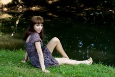 Free Beautiful Girl Sitting On Bank Of A River Stock Photo - 20699500