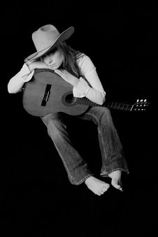 Free Singer With A Cowbit Hat And Guitar Royalty Free Stock Photos - 2072458
