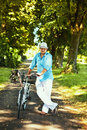 Free Romantic Man Standing With Bicycle In The Park Royalty Free Stock Photos - 20701908
