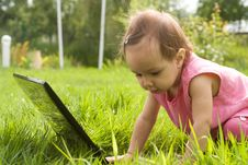 Free Baby With Laptop Stock Images - 20700334