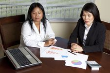 Free Two Asian Women At Desk With Laptop Royalty Free Stock Image - 20701766
