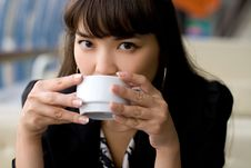 Businesswoman Drinking Tea Royalty Free Stock Image
