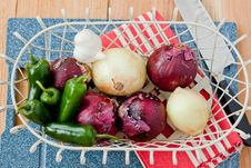 Onions And Peppers In A Basket Royalty Free Stock Images
