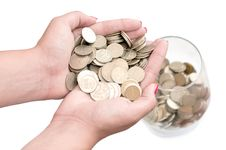 Free Stack Of Coins, Arms, And A Glass Royalty Free Stock Image - 20704836