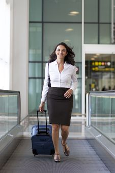 Businesswoman Runs At The Airport