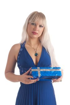 Beautiful Blonde In A Dark Blue Dress With A Gift Royalty Free Stock Photos