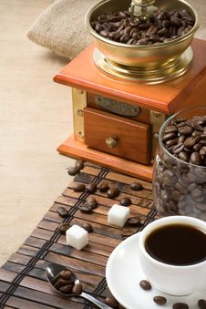 Cup Of Coffee And Grinder With Beans Stock Photo