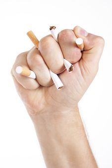 Man S Hand Crushing Cigarettes Royalty Free Stock Images