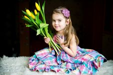 Portrait Of Adorable Sunny Child Girl With Tulips Royalty Free Stock Image