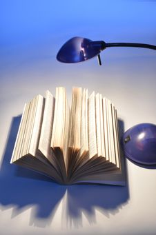 Reading Lamp And Good Book Stock Photography