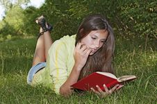 Free A Girl Reads A Book Royalty Free Stock Photography - 20714967