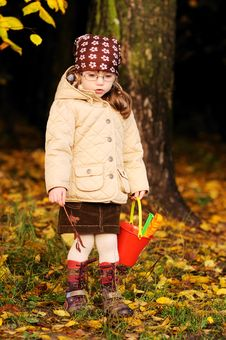 Cute Toddler Girl Walks In Autumn Forest Royalty Free Stock Photos