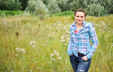 Free Young Pretty Woman Poses Standing In The Meadow Stock Photo - 20715420