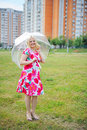 Free Adorable Blond Woman Poses Outdoors With Umbrella Royalty Free Stock Photo - 20720085