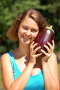 Free Girl Holding A Aubergine Royalty Free Stock Photos - 20726178
