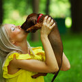 Free Woman Dachshund In Her Arms Stock Photos - 20726333
