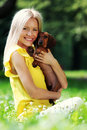 Free Woman Dachshund In Her Arms Stock Photos - 20726353