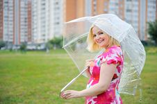 Free Adorable Blond Woman Poses Outdoors With Umbrella Stock Image - 20720091