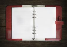 Blank Note Book On Wood Stock Photos