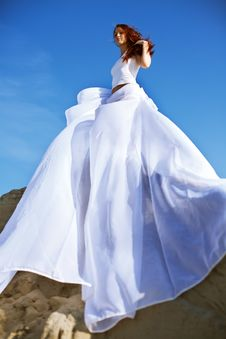 Young Blond Woman In White Dress Stock Photography
