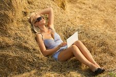 Free Woman On Laptop In Hay Stack Stock Photos - 20725403