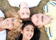 Free Happy Family Of Four On Grass Royalty Free Stock Image - 20725406
