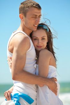Romantic Couple On A Beach Stock Photos