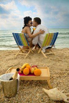 Free Couple Resting On The Beach Stock Images - 20725554