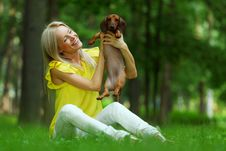 Free Woman Dachshund In Her Arms Stock Image - 20726341