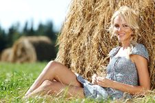 Free Girl Next To A Stack Of Hay Stock Image - 20726611