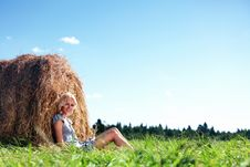 Free Girl Next To A Stack Of Hay Royalty Free Stock Photos - 20726618