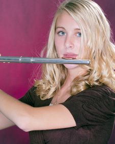 Flute Player Isolated On Pink Royalty Free Stock Photos