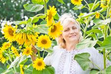 Free Happy Woman With Sunflowers In Her Garden Stock Image - 20728981