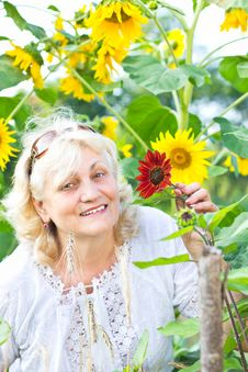 Free Happy Woman With Flowers In Her Garden Stock Images - 20728984