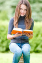 Free Happy Student Girl Sitting On Pile Of Books Stock Image - 20734001