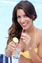 Free Pretty Brunette Sipping Drink Near Pool Royalty Free Stock Photo - 20738325