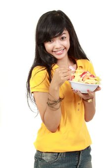 Free Young Healthy Girl Having A Fruit Salad Royalty Free Stock Photography - 20731937