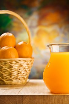Free Jug With Orange Juice And Oranges In Busket Royalty Free Stock Photo - 20734145