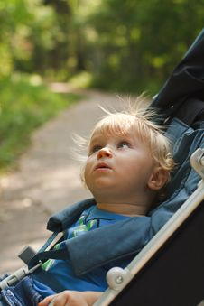 Curious Baby In Pram Stock Photo