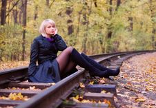 Beautiful Girl Posing On Rails In Autumn Park Royalty Free Stock Photos