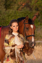 Free The Woman In Clothes Of 18 Centuries With Horse Stock Image - 20744091