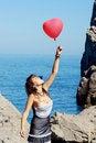 Free Beautiful Girl Keeps Air Ball Near Sea Royalty Free Stock Photos - 20749258