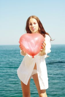 Free Girl Keeps Air Ball In Form Heart Stock Photo - 20749120