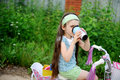 Free Long-haired Child Girl Drinks While Riding Bike Royalty Free Stock Photography - 20757737