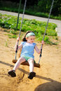 Free Happy Child Girl Is Swinging In The Playground Royalty Free Stock Photo - 20757815